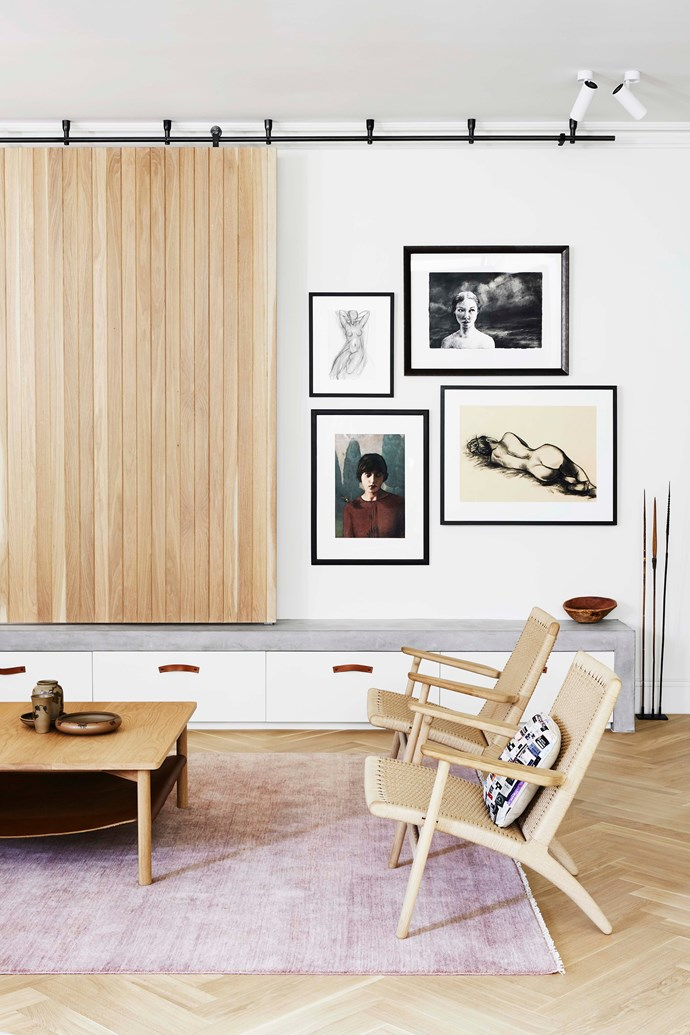 "In the living room, a sliding timber panel keeps the television out of sight when not in use. Hans J Wegner 'CH25 Easy Chairs' by [Carl Hansen & Søn](https://www.carlhansen.com/en|target=""_blank""