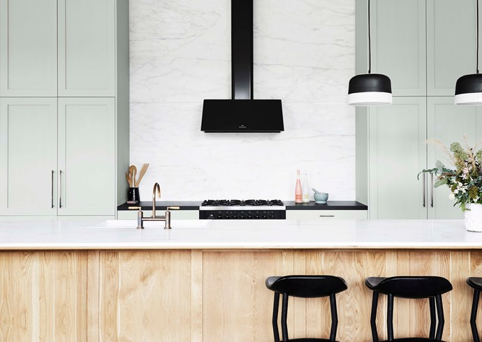 "Statuario marble benchtop on American oak in the kitchen. 'Potter' pendant lights from [Anchor Ceramics](https://www.anchorceramics.com/#anchor-ceramics|target=""_blank""