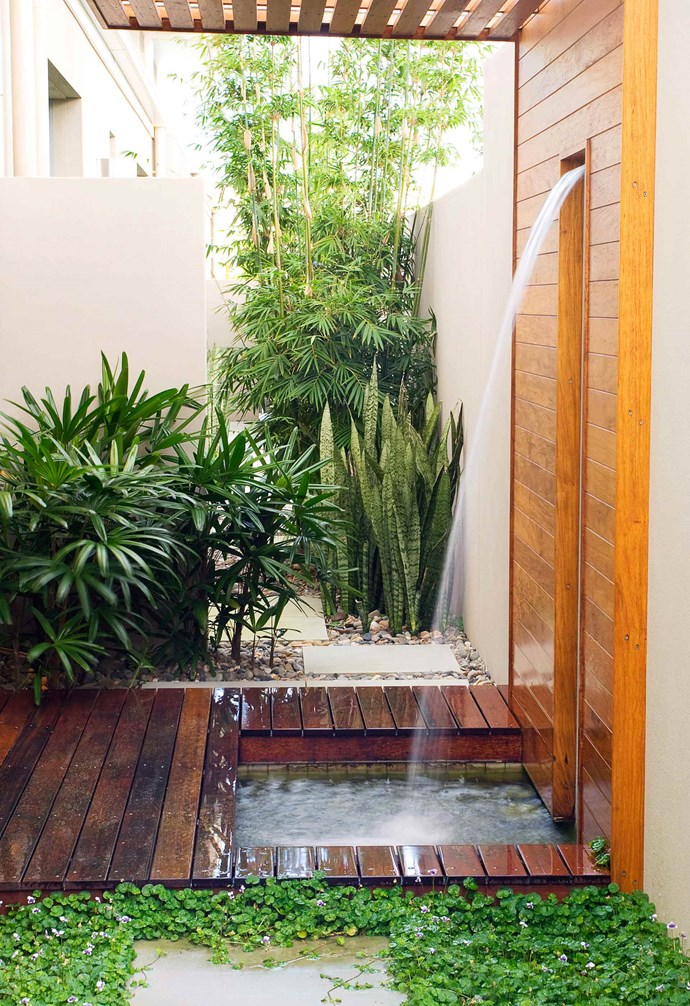 This built-in approach to an out-door shower would have required a bit more work, but the result is so worth the effort. *Photography: Steve Ryan | Australian House & Garden.*
