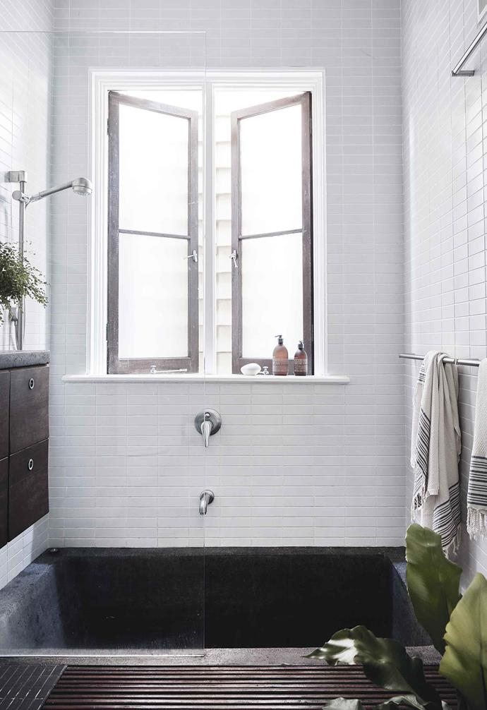 "**Bathroom** Louisa and Ryan haven't touched any of the bathrooms. ""I love the sunken granite bath in the upstairs bathroom,"" she says."
