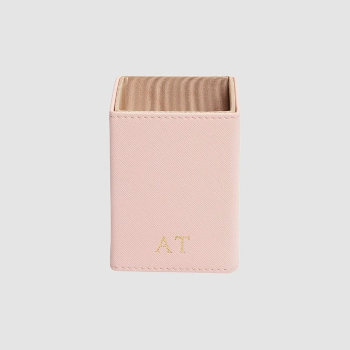 """**Pen holder** in pale pink, $39.95, from [tde.](https://www.thedailyedited.com/pale-pink-square-penholder