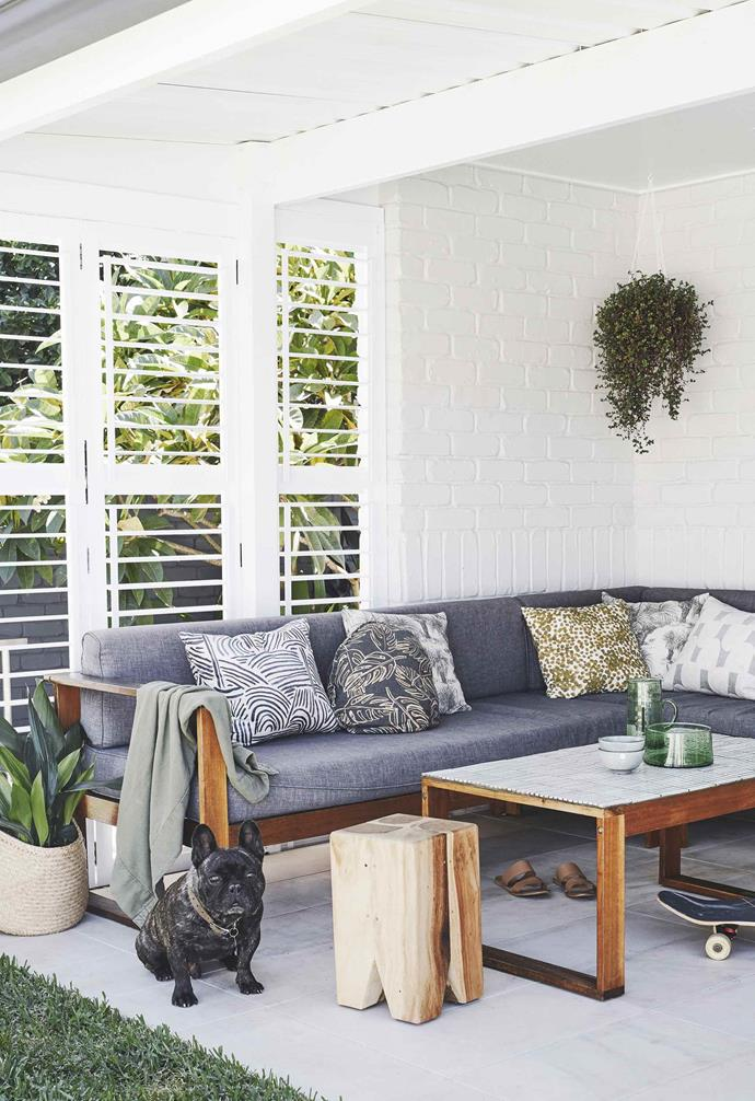 """**Patio** The covered verandah features a unique upscaled coffee table from [Bunnings](https://www.bunnings.com.au/