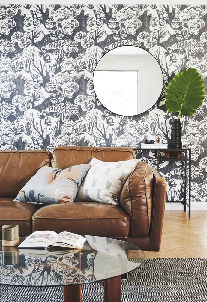 """**Living area** The leather sofa from Freedom really pops against the striking 'Reef' wallpaper from [These Walls](https://thesewalls.com.au/