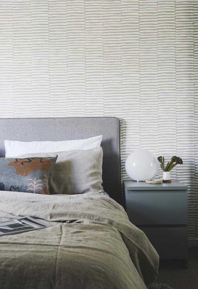 """**Master bedroom** An expanse of 'Stripes Anon' wallpaper in Stone, also from [These Walls](https://thesewalls.com.au/