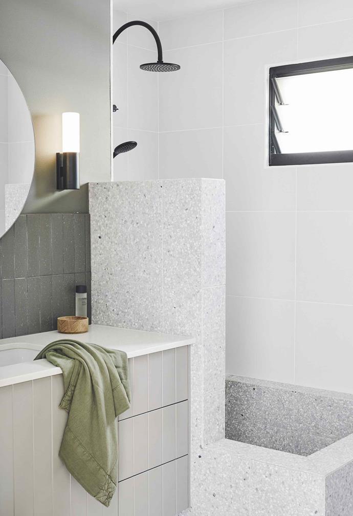 "**Bathroom** The combined shower/bath, lined in 'Dove Grey' terrazzo tiles from [Fibonacci Stone](http://www.fibonaccistone.com.au/|target=""_Blank""|rel=""nofollow""), is inspired by Roman tubs. Showerhead and mixer, [Astra Walker](http://www.astrawalker.com.au/|target=""_Blank""|rel=""nofollow""). 'Jupiter' sconce, [Beacon Lighting](https://www.beaconlighting.com.au/|target=""_blank""|rel=""nofollow""). Custom vanity, Parkin Cabinets, painted in [Haymes Paint](https://www.haymespaint.com.au//|target=""_blank""|rel=""nofollow"") in Eureka. Custom mirror, [Kira & Kira](http://www.kiraandkira.com.au/|target=""_blank""|rel=""nofollow""). Surface Society 'Split' terracotta tiles in grey (splashback), [Byron Bay Tile Merchants](http://byronbaytilemerchants.com.au/|target=""_Blank""|rel=""nofollow"")."