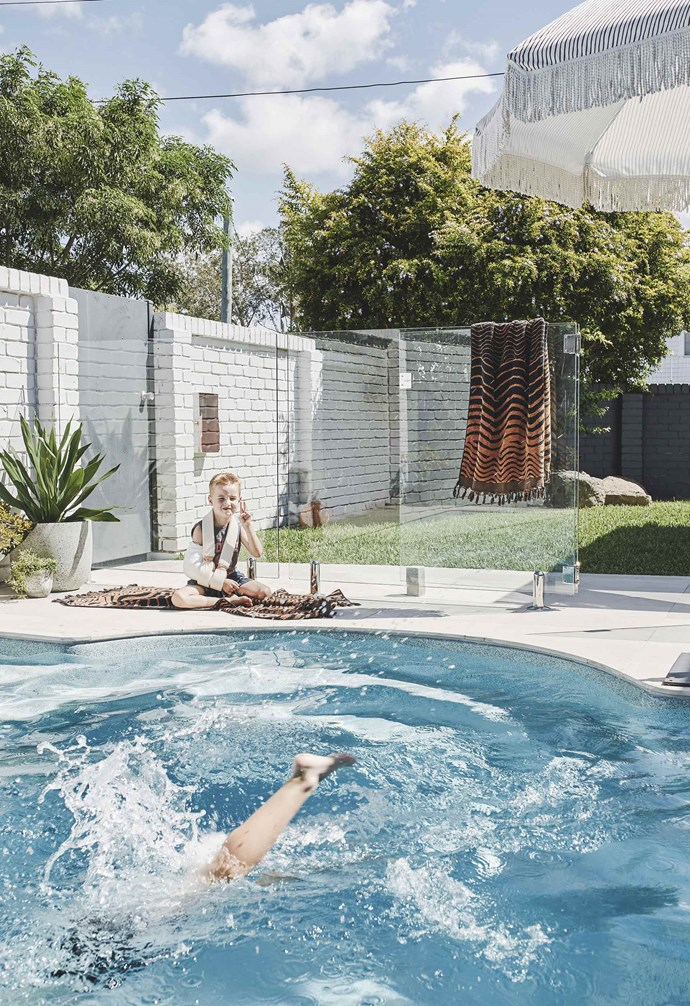 **Pool area** With boisterous boys to keep an eye on, glass fencing gives the yard a stylish, safety-conscious update. A 'Natural Instinct' umbrella from Sunday Supply Co provides shade, with towels from Kip&Co.