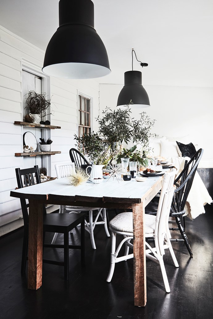 """Rob made their dining table using timber from a friend's property. It's just the right size for having lots of friends over. """"We love to entertain,"""" Lisa explains.""""It's a special thing to host people and make them feel loved, relaxed and welcome."""""""