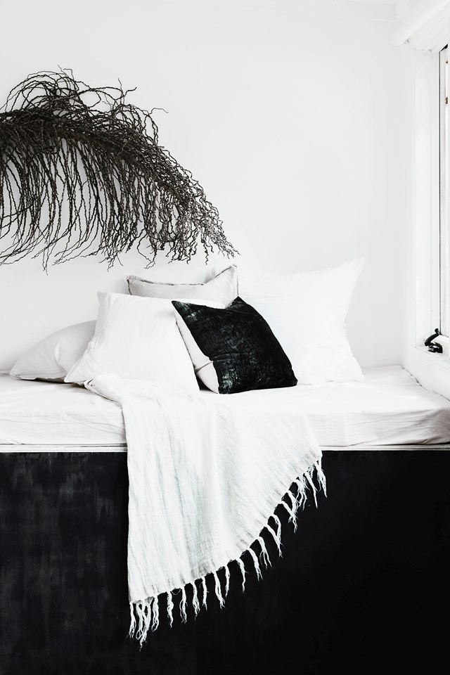 "A soothing monochrome palette and natural materials give this daybed in this [charming holiday cottage](https://www.homestolove.com.au/the-cottage-kangaroo-valley-19551|target=""_blank"") a cosy and relaxed feel. *Photo:* Maree Homer"