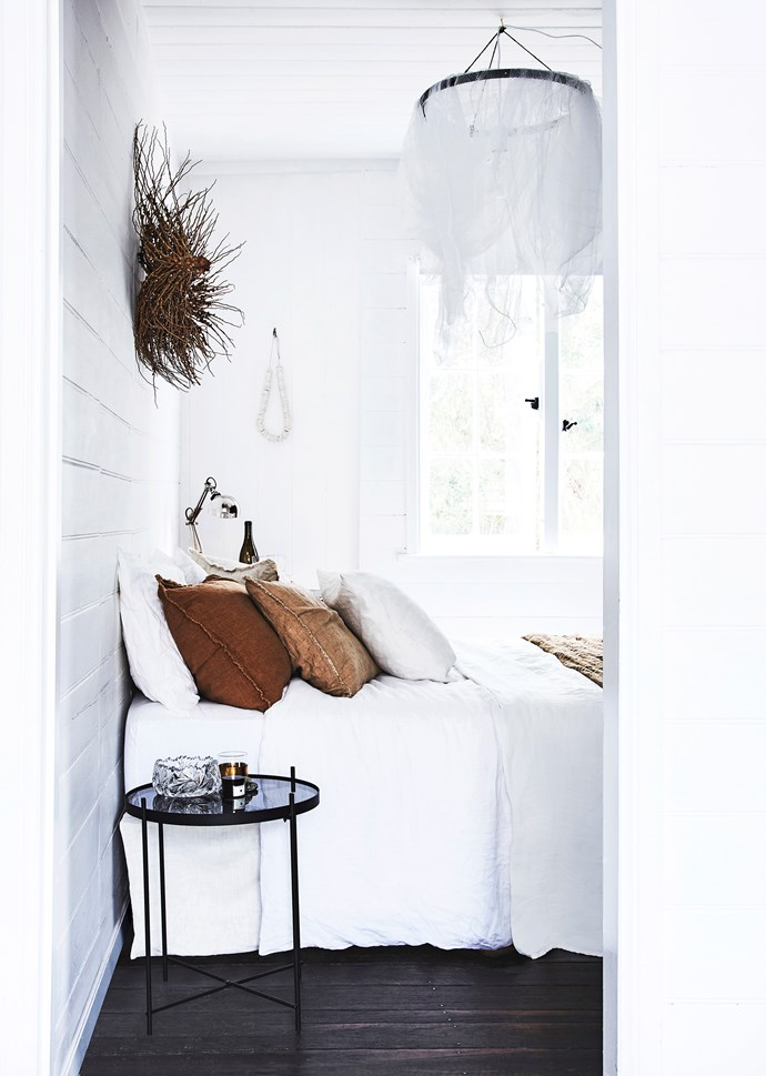 Breathable linen bedding is a luxury on hot summer nights. These Hale Mercantile Co linen pillowcases and sheets are from Camargue. Lisa made the white net lights, and the glass bowl was a vintage find.