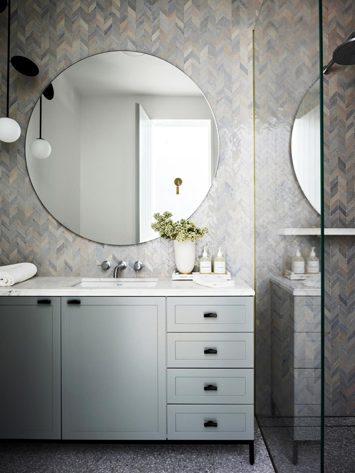 The powder room has a custom mirror by Arent&Pyke. Ait Manos tiles from Onsite Supply & Design. Atelier Areti 'Plates' pendant light.
