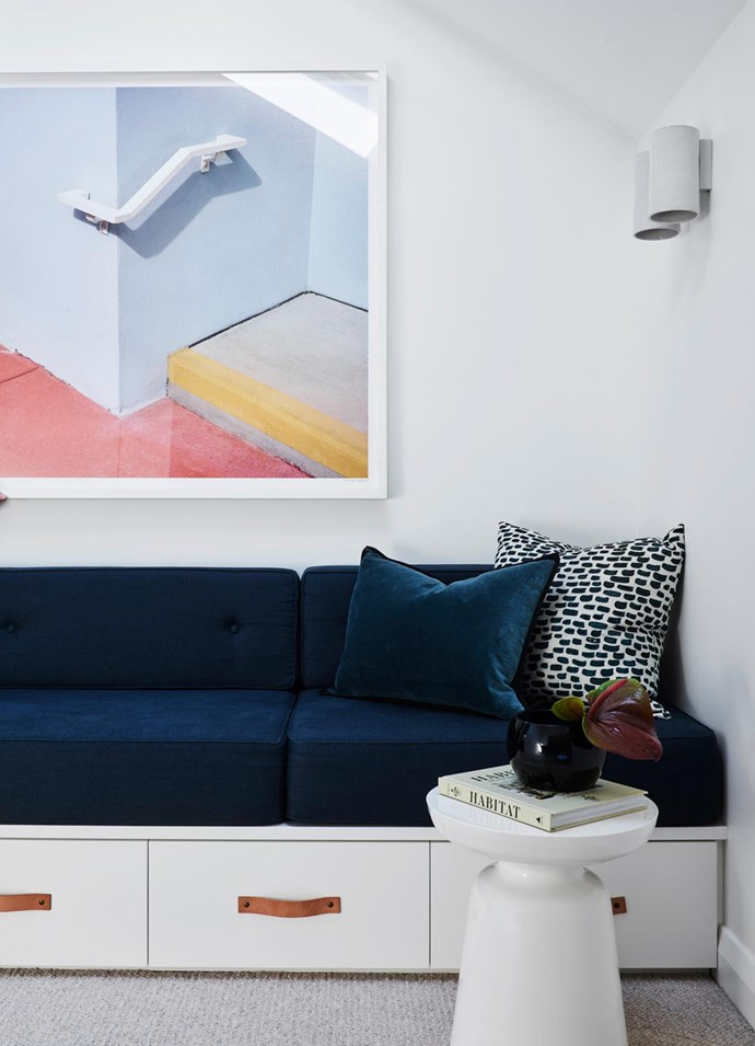 On the landing, a marine linen custom bench seat by Arent&Pyke provides a stopping-off point before bedtime. Artwork by George Byrne from Olsen Gallery.