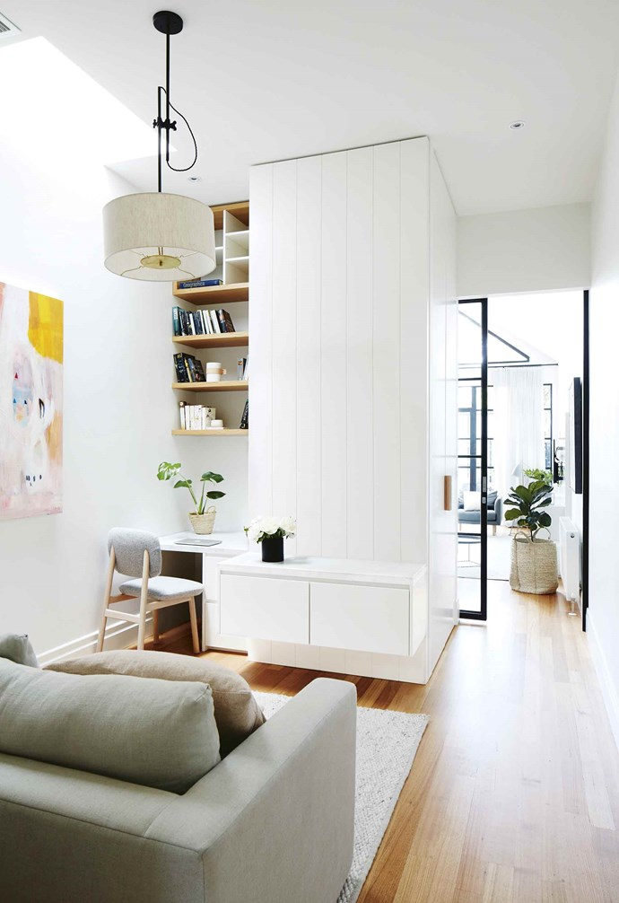 "**Go vertical** If going wide isn't an option, think about going up instead like in [this Scandinavian-style Melbourne home](https://www.homestolove.com.au/scandinavian-style-makeover-in-the-heart-of-melbourne-17515|target=""_blank""). In this narrow living room study nook, ample shelving is installed almost all the way to the ceiling, keeping the desk surface clear. The cosy lounge behind the nook completes the home office area, allowing an option for more comfortable working. *Styling: Heather Nette King 