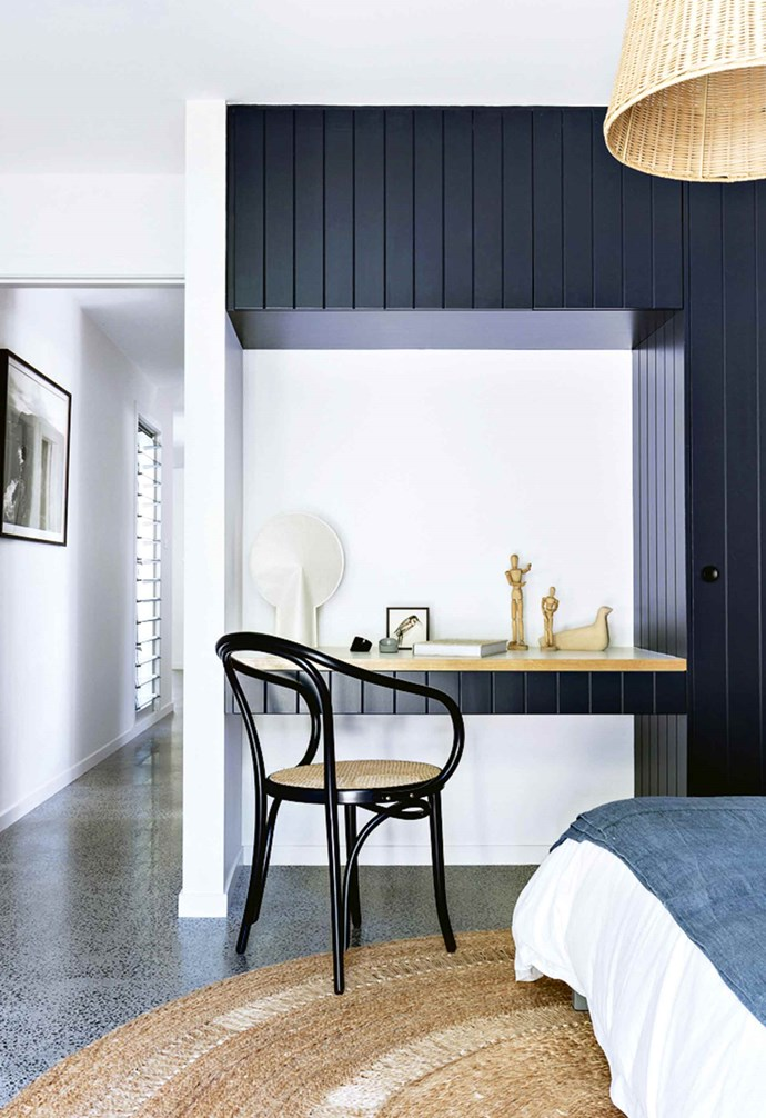 "**Natural extension** In this [serene beach house](https://www.homestolove.com.au/tour-a-serene-beach-house-inspired-by-nature-18226|target=""_blank"") the architect created an extension of the panelled black wardrobe in one of the bedrooms which functions as a makeshift home office when needed. By echoing the paint colour and panelled look of the wardrobe, the study nook works seamlessly with the rest of the room. *Styling: Claire Delmar 