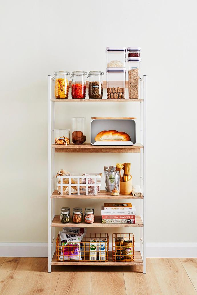 Vigo wide shelves in White, $99.95, Mocka. **ON TOP SHELF FROM LEFT:** 1.5L glass preserving jars, $5 each, Target. OXO Pop containers, $150 for set of 10, Williams Sonoma. **ON SECOND SHELF FROM LEFT:** Glass jars, $12.99 for small and $19.99 for large, H&M Home. Bread bin with cutting board, $15, Kmart. **ON BOTTOM SHELF:** The Baskets baskets in Mustard, $59 for set of 3, Mustard.