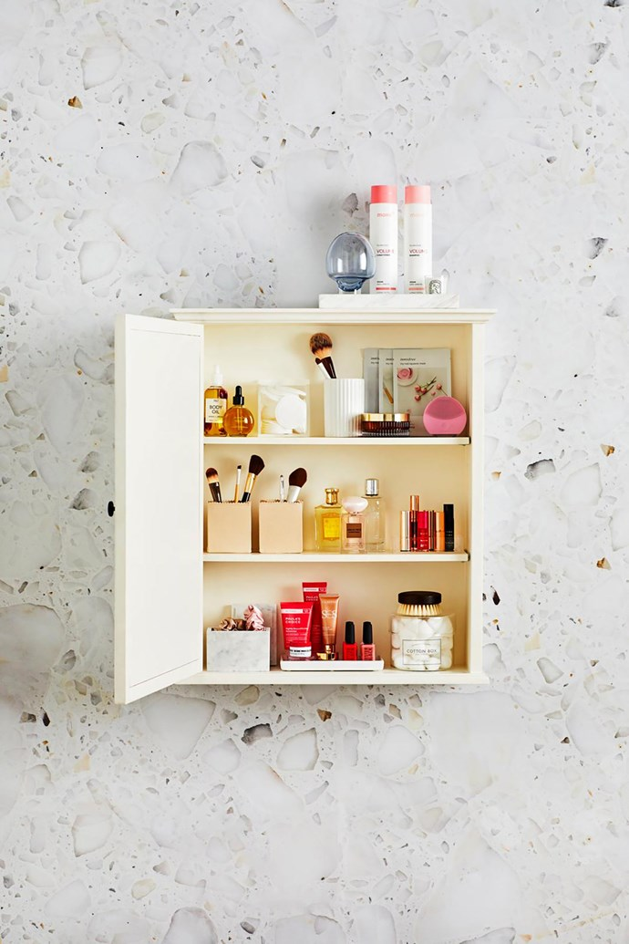 """**ON CABINET:** Home Republic """"Eastside"""" marble tray, $49.99, Adairs. **MIDDLE SHELF:** Pinsel leather boxes in Natural, $39.95 each, Gingerfinch. **BOTTOM SHELF:** Loft storage box in Snow, $49.95, Country Road."""