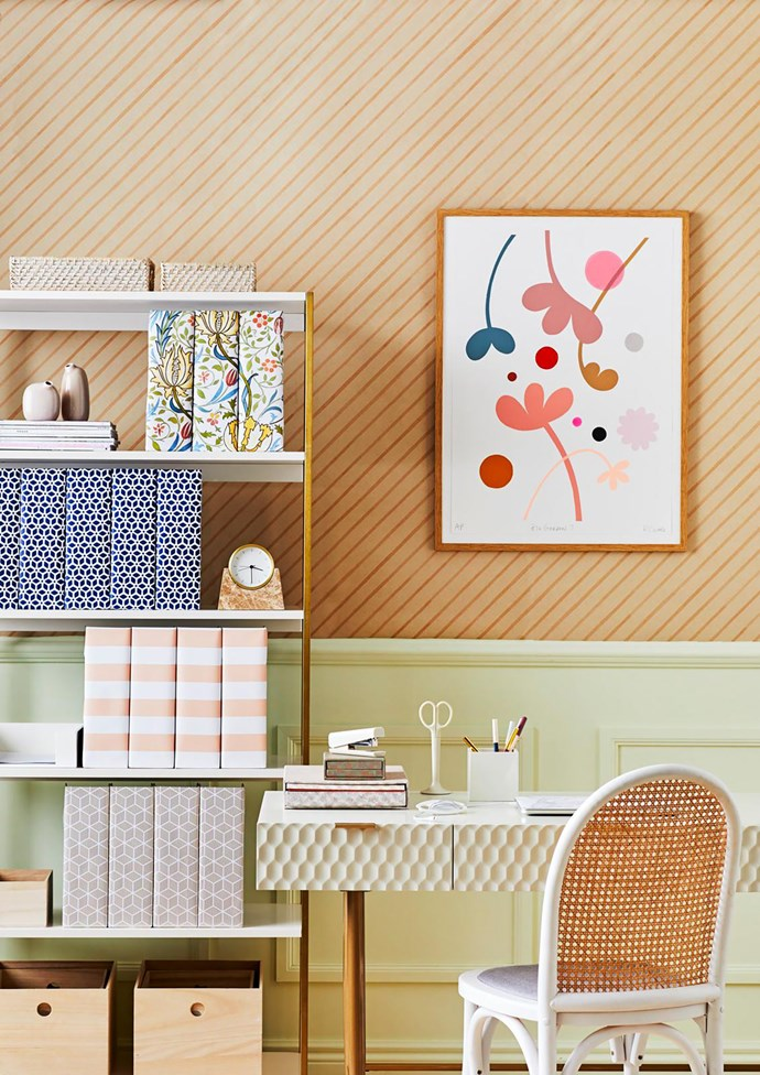 **ON BOOKSHELF FROM TOP TO BOTTOM:** Modern weave baskets in Whitewash, $19 for small and $29 for medium, West Elm. Collapsible cardboard magazine files, $3.99 each, Officeworks, covered in different styles of wrapping paper. Large storage box, $27.99, H&M Home.