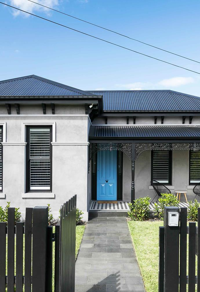 """""""The original house was built around 1910. It was very hard to see its Victorian features as the home had been badly renovated in the 70's, and most of its charm had been removed,"""" explains Steph, """"It looked pretty dire, to be honest.""""<br><br>**Facade** One of the core focuses of the renovation was restoring and re-introducing traditional details to the home. The grey rendered [facade](https://www.homestolove.com.au/fabulous-facades-18972 target=""""_blank"""") pairs beautifully with dark fencing and roofing, and a vibrant blue [front door](https://www.homestolove.com.au/front-doors-australia-6476 target=""""_blank"""") elevates the home's [kerb appeal](https://www.homestolove.com.au/kerb-appeal-ideas-for-styling-your-home-exterior-18991 target=""""_blank"""" rel=""""nofollow"""")."""
