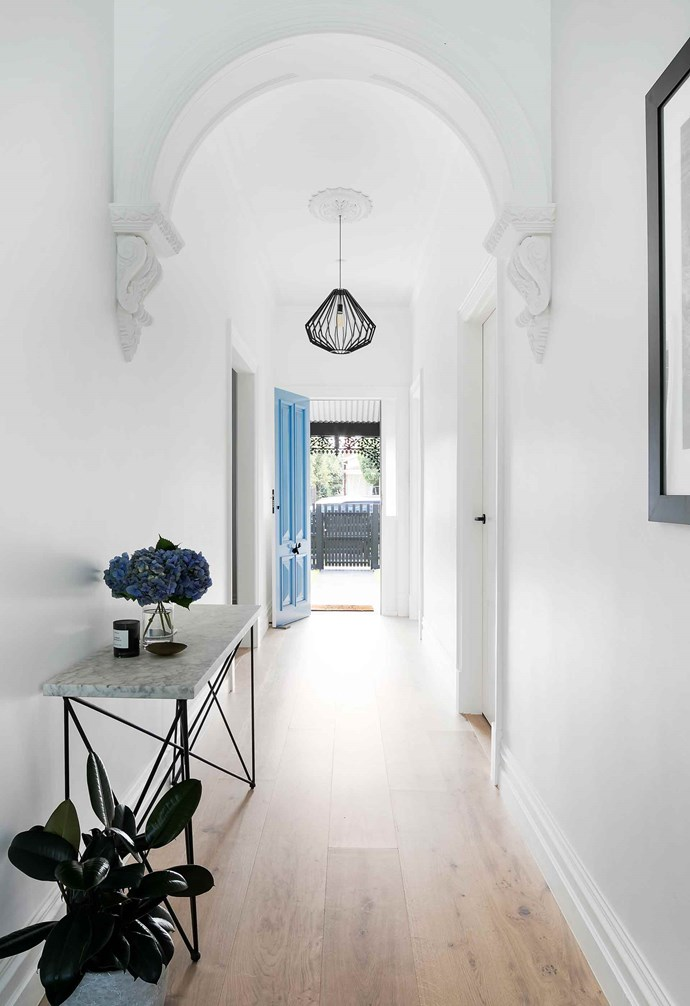 """Resilience is key when it comes to tackling a large-scale renovation, and this was no exception. """"The hallway arch that we both loved was in a very bad state as it had been repainted a million times, but luckily the supplier I had been recommended for all of our ornamental plasterwork, had the very same profile as our original hallway arch. We found out that they had made our original one over 100 years ago, as no supplier has exactly the same profile, which was really exciting,"""" says Steph.<br><br>**Hallway** The restored archway makes a dramatic statement in the [hallway](https://www.homestolove.com.au/hallway-and-entrance-ideas-to-create-a-warm-welcome-2018 target=""""_blank""""), working seamlessly with the traditional features the reno rookies were aiming to reinstate."""