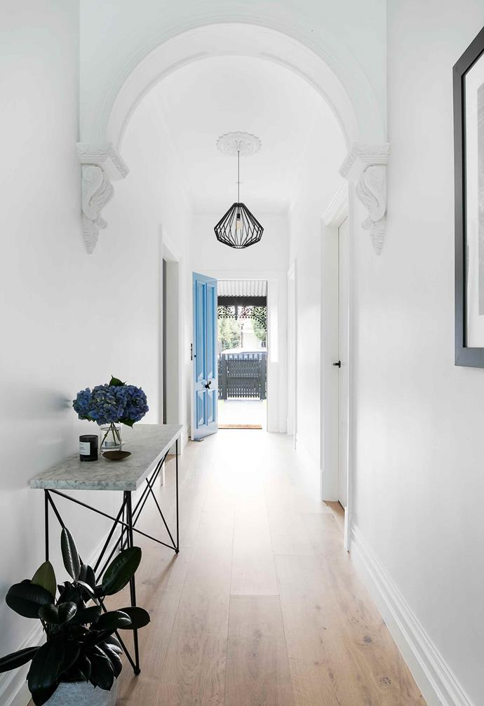 "Resilience is key when it comes to tackling a large-scale renovation, and this was no exception. ""The hallway arch that we both loved was in a very bad state as it had been repainted a million times, but luckily the supplier I had been recommended for all of our ornamental plasterwork, had the very same profile as our original hallway arch. We found out that they had made our original one over 100 years ago, as no supplier has exactly the same profile, which was really exciting,"" says Steph.<br><br>**Hallway** The restored archway makes a dramatic statement in the [hallway](https://www.homestolove.com.au/hallway-and-entrance-ideas-to-create-a-warm-welcome-2018