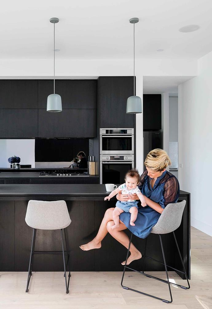 """The renovation process started for Steph with a deep dive through [Pinterest's extensive archives of inspiration](https://www.pinterest.com.au/insideoutpins/pins/ target=""""_blank"""" rel=""""nofollow""""), and very quickly a common style emerged, with Steph remarking that, """"it was reassuring to see a real theme running through it: a [monochromatic palette](https://www.homestolove.com.au/this-renovated-melbourne-terrace-features-a-striking-monochrome-palette-16998 target=""""_blank"""") with light floorboards and pops of colour."""" <br><br>**Kitchen** In the [kitchen](https://www.homestolove.com.au/kitchens-with-clever-design-ideas-to-steal-6962 target=""""_blank"""") the monochromatic look comes to the forefront with dark cabinetry popping against the mostly white interior of the rest of the home. Grey barstools with a simple silhouette softens the kitchen space, and a trio of ceramic pendant lights hang above the [kitchen island](https://www.homestolove.com.au/kitchen-inspiration-13-of-the-best-island-benches-17943 target=""""_blank"""")."""
