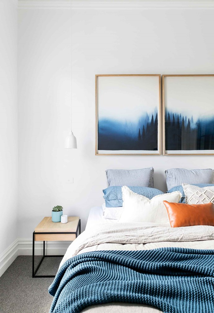 """""""Modern homes can sometimes feel a bit soulless, so reinstated large skirting boards and architraves, ceiling roses and cornices, because these features would be what would forever make the house feel like it had history, and stories to tell,"""" says Steph.<br><br>**Master bedroom** Skirting and cornices were reinstalled throughout the home, restoring a refined and traditional aesthetic to the house. In this bedroom twin artworks introduce colour into the space which is echoed in the walk-in wardrobe."""