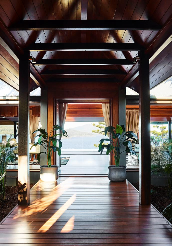 Rosewood lines the entrance, mirroring the grand lobby of Qualia.