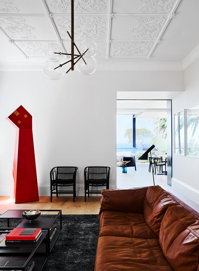 The Aleks Danko sculpture provides a punch of colour and strong form in an otherwise neutral palette. 'Square 16' sofa by DePadova. 'Bolle' ceiling light by Gallotti & Radice.