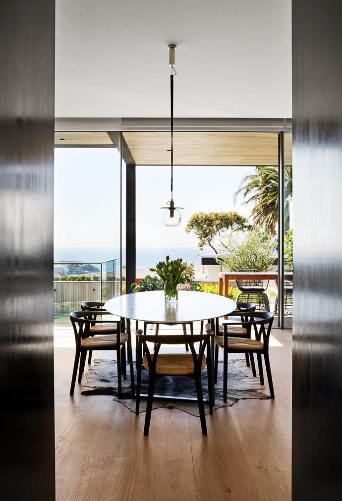 'Dritto' dining table in Lithoverde by Piero Lissoni for Salvatori is surrounded by DePadova 'Donzelletta' dining chairs.