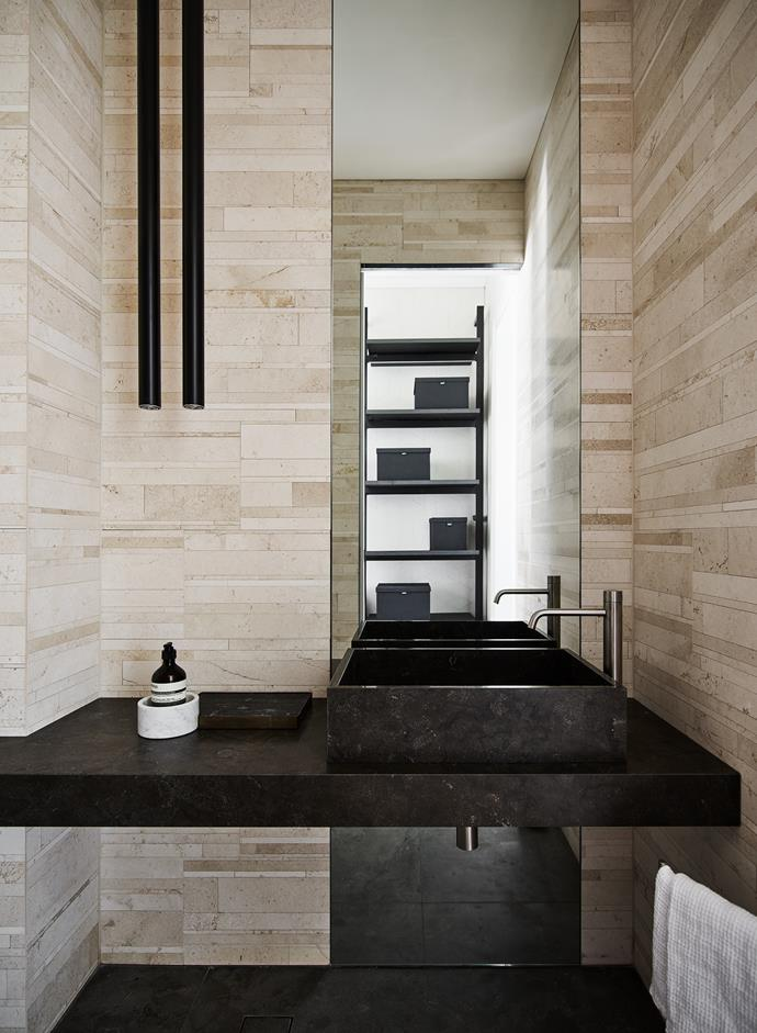 The tiles in the powder room echo the warmth of Sydney sandstone.