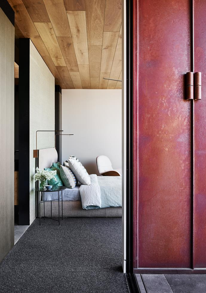 The bedroom with its timber ceiling and Donghia raffia wallpaper behind the bed has a softness not seen elsewhere in the house.