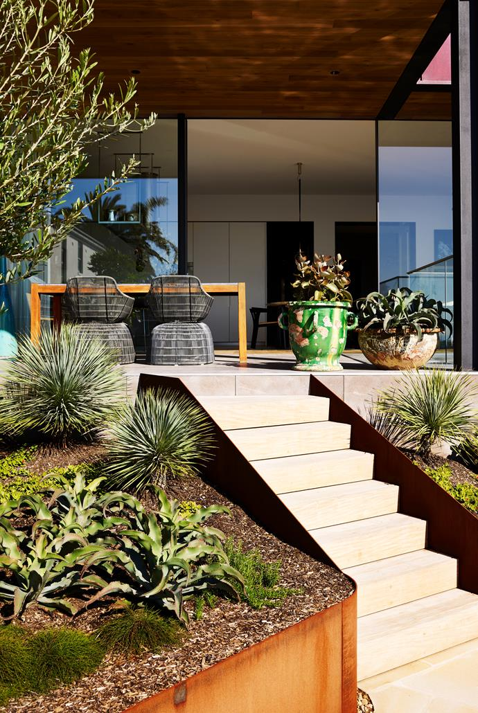 The garden by Dangar Barin Smith is still in its early stages and is designed to grow beyond its Corten steel containers and create a loose, lush planting scheme.