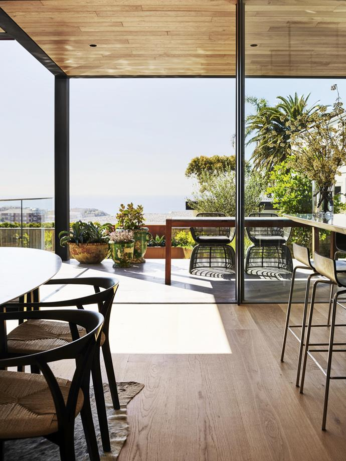 The view onto the deck adjacent to the kitchen takes in the ocean beyond.