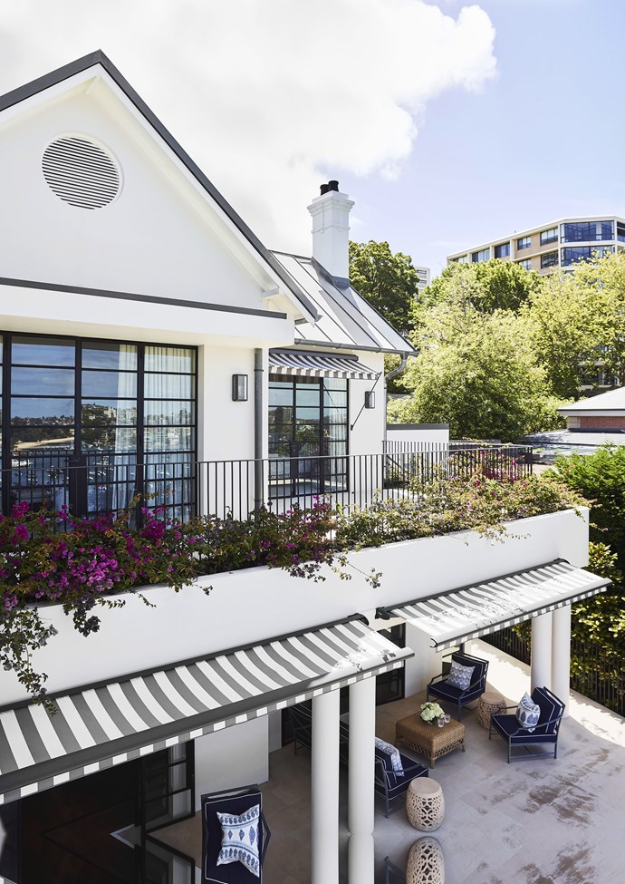 Black and white striped awnings perfectly match the external colour scheme of this luxurious Sydney home. *Photo: Anson Smart / bauersyndication.com.au*