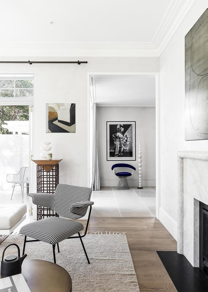 Arflex 'Neptunia' armchair from Poliform on a 'Malawi' rug by Armadillo&Co. Artwork by Maria Kostareva above pedestal 