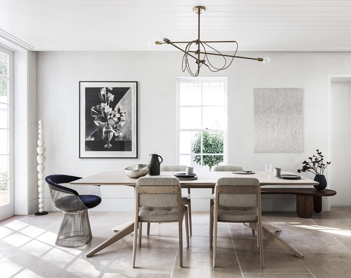 Dining table by Matthew Hilton with 'Capo' chairs by Neri & Hu, all from Spence & Lyda. Alessandro Di Sarno water jug from Planet. Ceramic dinner plates from Montmartre Concept Store. Tom Dixon 'Bash' silver bowl from De De Ce. Artwork by Heidi Yardley.