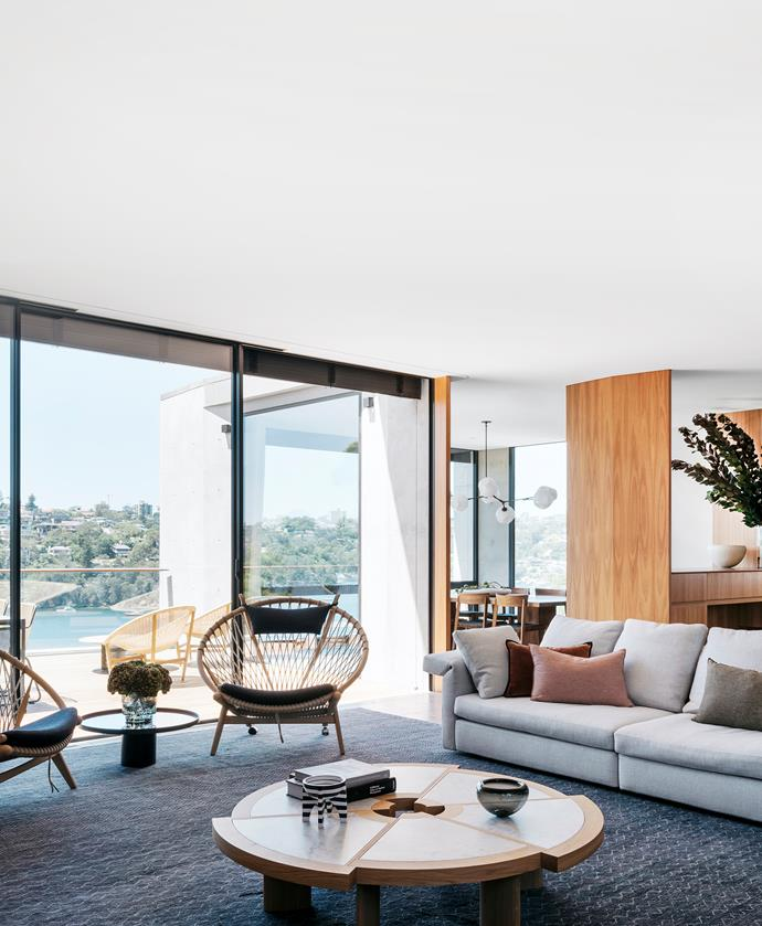 Details such as the plush textiles and hand-knotted rug soften the timber and tiles. Minotti 'Collar' sofa, Dedece. Domo. Cassina coffee table and side tables. 'Circle' chairs, Great Dane. Kelly Wearstler striped vase, Becker Minty. Rug, Robyn Cosgrove.