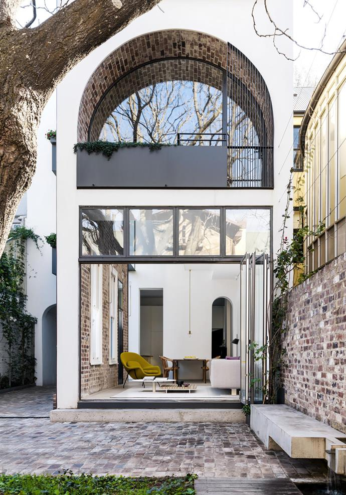 Soaring ceilings and a brick barrel vault provide drama in this remodelled 1890s Sydney terrace house conceived by architect Renato D'Ettorre. *Photograph*: Justine Alexander. From *Belle* February/March 2019.