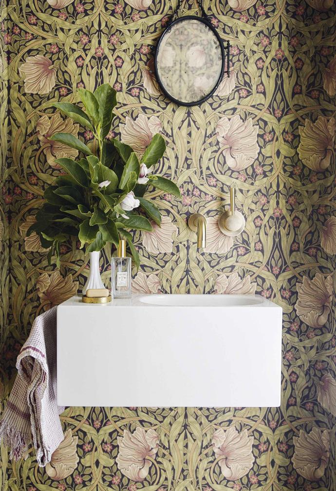 "**Powder room** Wow factor is added to the basement's powder room with ornate William Morris wallpaper. Vanity, Alape, [Reece](https://www.reece.com.au/|target=""_blank""
