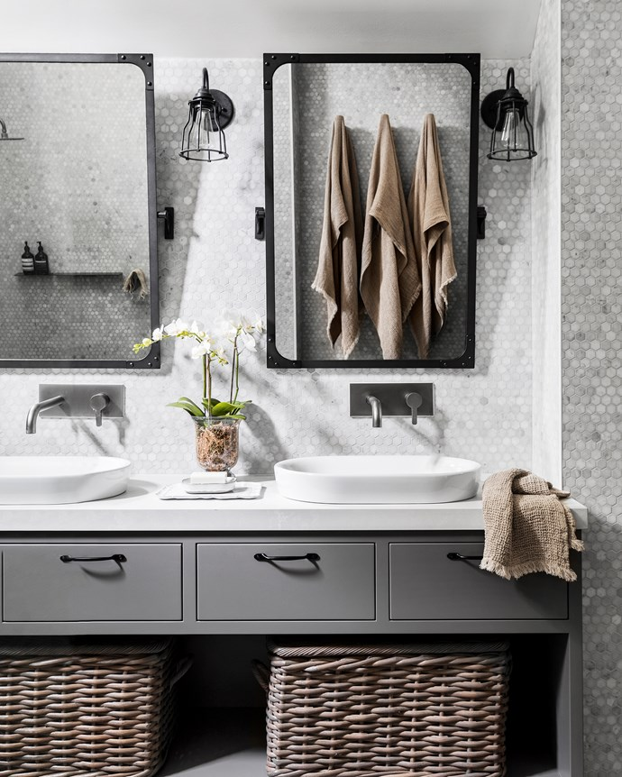 Signorino tiles complement the vanity top made by a local craftsman. Lights and tilt mirrors, Restoration Hardware (US). Baskets, Pottery Barn.