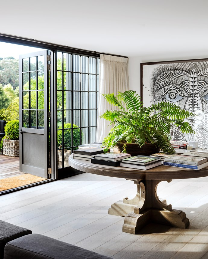 Between the guest quarters and family room is this transitional area leading out to the garden. Round table, Restoration Hardware (US). Artwork by Joshua Yeldham.