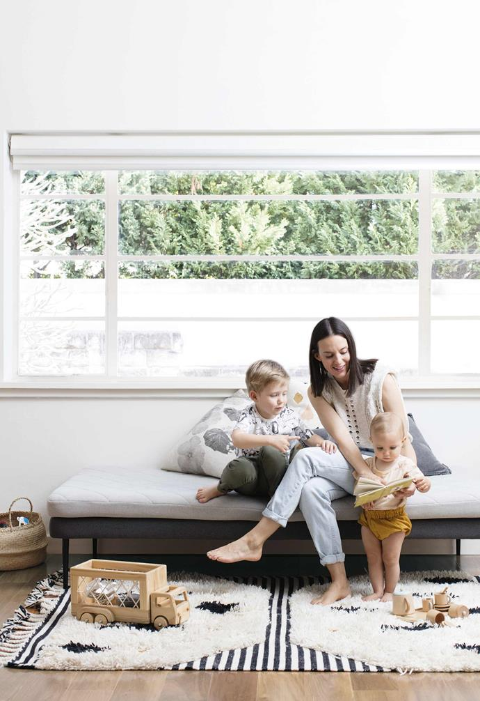"""**Sunroom** Homeowner Françoise also uses this area as a playroom for son Xavier and daughter Lucette. Toys rest on a 'Desert' rug from Langdon Ltd. Cushions,'Pansy black', [Bonnie and Neil](http://www.bonnieandneil.com.au/ target=""""_blank"""" rel=""""nofollow""""). 'Leopard', [LangdonLTD](https://langdonltd.com.au/ target=""""_blank"""" rel=""""nofollow""""). denim cushion, [EadieLifestyle](https://www.eadielifestyle.com.au/ target=""""_blank"""" rel=""""nofollow"""")."""