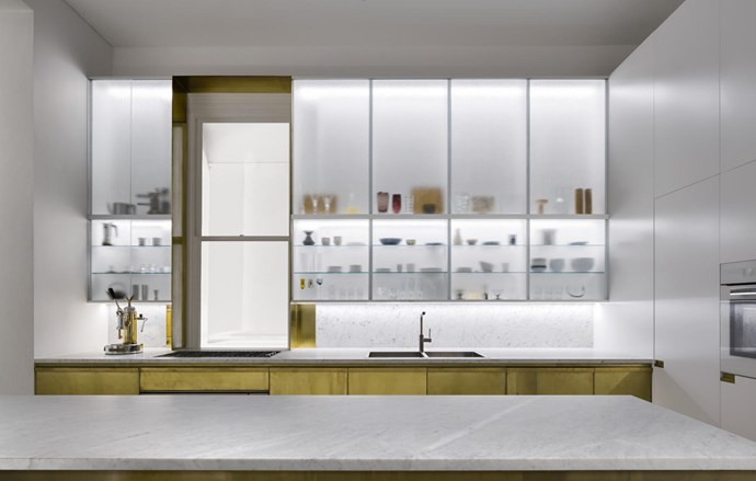 In the main kitchen on the ground floor, honed Carrara marble benchtop and splashback from Nefiko Marble. Custom brass and two-pack polyurethane cupboard doors with custom brass handles. Micro S1C coffeemaker in chrome and brass from Elektra. Barazza 'Lab' oven and cooktop in stainless steel and Barazza 'Cubo' sink, all from Winning Appliances. a2f-tapware 'Tartana + lateral spray' tap from Candana.