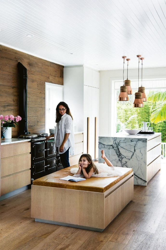 """**To the side** Contrary to popular belief, kitchen islands don't have to be the hero of your open-plan kitchen-dining-living zone. In this [beachside home](https://www.homestolove.com.au/how-to-create-the-beachside-look-with-natural-light-and-timber-17440