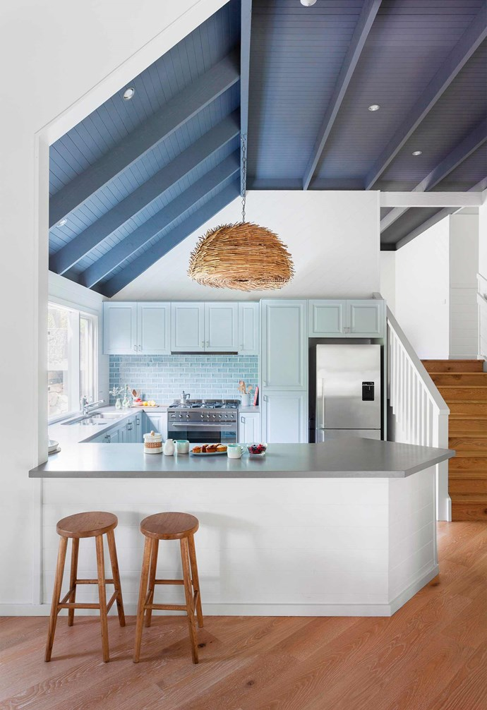 **Connectivity** Rather than featuring a floating island, this kitchen's island bench acts as a boundary line to separate the kitchen from the rest of the home. The angled edge visually softens the impact. *Photography: Martina Gemmola / bauersyndication.com.au*