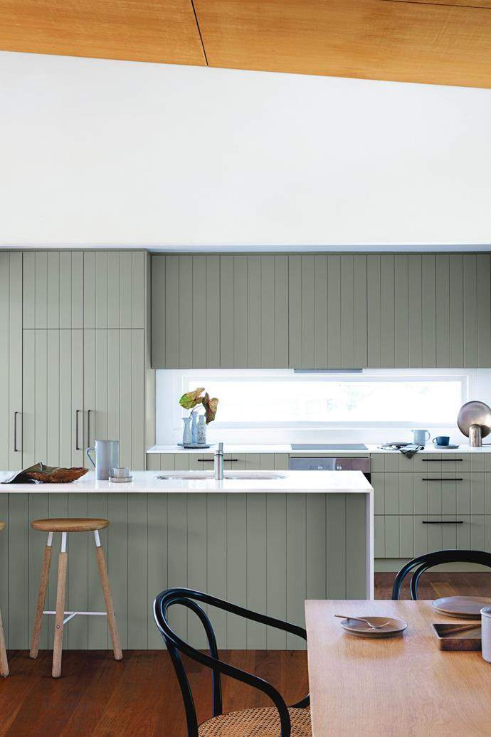 "**Colour splash** In this [serene nature-inspired beach house](https://www.homestolove.com.au/tour-a-serene-beach-house-inspired-by-nature-18226|target=""_blank"") the kitchen cupboards were replaced with painted shiplap cabinetry that is echoed in the kitchen island. Topped with a simple white benchtop, the muted colour in this kitchen packs a punch. *Styling: Claire Delmar 