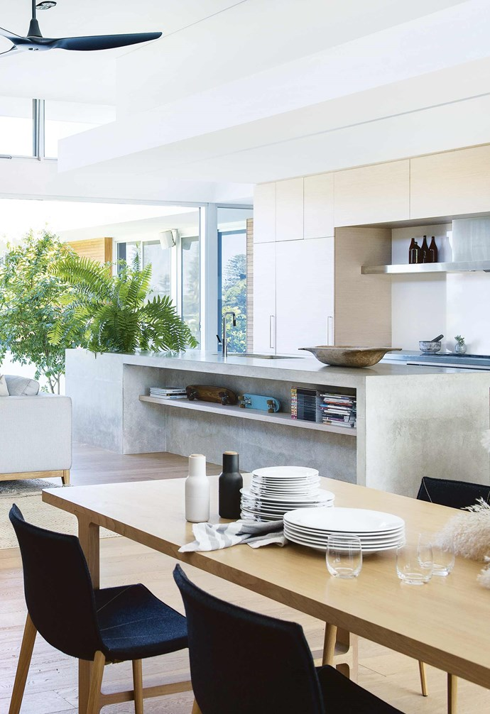 """**Versatility** This custom concrete kitchen island in this [bright and airy Perth home](https://www.homestolove.com.au/tour-this-bright-and-airy-perth-home-17078