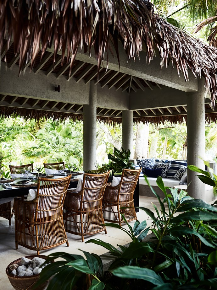 Adjoining the main house of this Vanuatu home designed by BKH and Bramley Constructions is an outdoor dining space with a natangura palm roof installed by locals. *Photograph*: Anson Smart. From *Belle* April 2017.