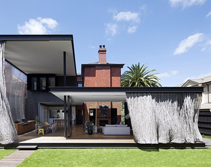 "The modern extension that architect Matt Gibson added to this [19th-Century Victorian home](https://www.homestolove.com.au/a-federation-home-with-a-modern-rear-extension-6353|target=""_blank"") allows for a better connection to the garden and a more sheltered outdoor space. *Photograph*: Shannon McGrath. From *Belle* February/March 2018."