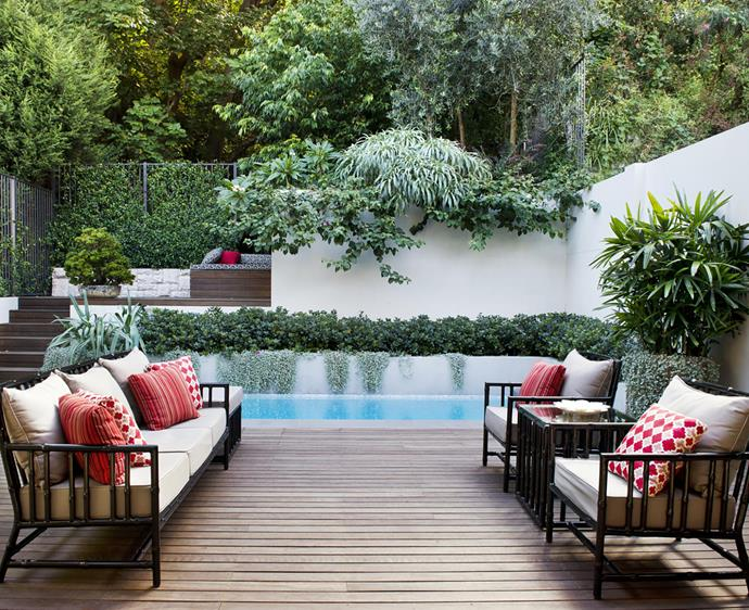 Goodmanors in Sydney took a sloping yard and created a multilevel pool and entertaining space with lush borrowed landscape behind it - a great example of the 'overgrown' aesthetic.