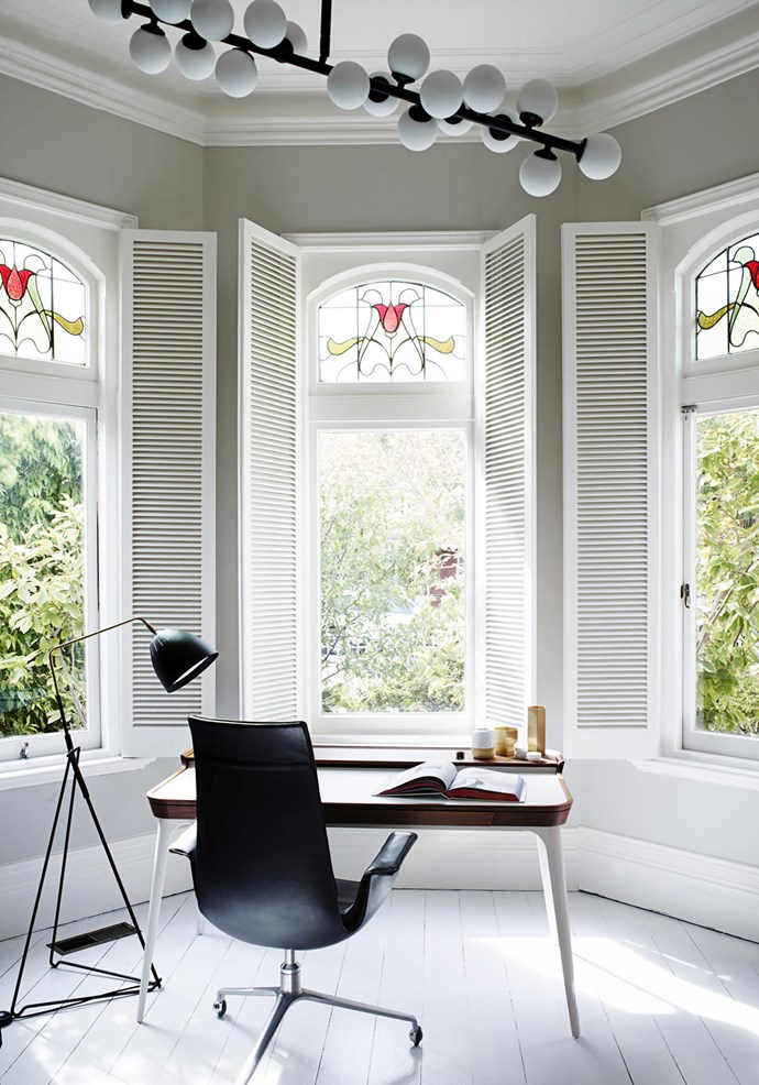 """The original bay windows with leadlight glass add a timeless element to the study area in this [Melbourne home](https://www.homestolove.com.au/home-refreshed-with-feminine-aesthetic-melbourne-19240